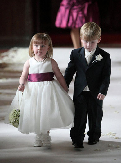 Page Boy and Flower Girl Holding Hands